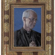 Archbishop Justin Welby with his portrait by artist Roger Wagner now hanging at Auckland Castle