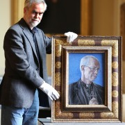 Artist Roger Wagner with his portrait of the Archbishop of Canterbury Justin Welby now hanging at Auckland Castle