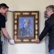 (far right) Artist Roger Wagner helping hang his portrait of Archbishop of Canterbury Justin Welby now hanging at Auckland Castle