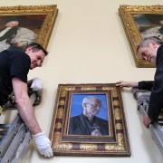 (far right) Artist Roger Wagner helping hang his portrait of Archbishop of Canterbury Justin Welby now hanging at Auckland Castle1